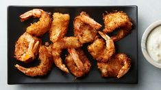 Jumbo shrimp tossed in sweet, crispy coconut flakes and dipped in creamy piña colada sauce may sound like something you've ordered before, but this coconut shrimp is unlike anything you've ever made before—guaranteed. Restaurant Dishes, Restaurant Recipes, Dinner Recipes, Dinner Ideas, Coconut Shrimp, Other Recipes, Quick Recipes, Fish And Seafood, Copycat Recipes