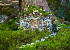 Greenspirit Arts: Prints on Paper - I LOVE this house with its stone walls, moss-covered roof, and flowers decorating all over; the pebble path is perfect for it too +++++++++++++++++ GreenSpiritArts #fairy #garden #house