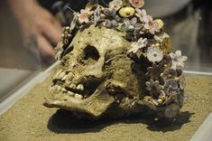Girl buried with a crown of ceramic Myrtle flowers