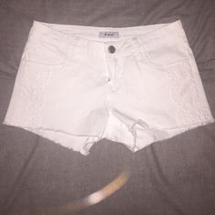 White shorts with lace! STS Blue, white Denim shorts with lace detail on the side.. Never worn great condition, any questions please ask! Sts blue Shorts