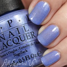 OPI:  Show Us Your Tips!  ... a vivid cornflower blue / periwinkle nail polish with iridescent glass-flecks ...  from the OPI Spring 2016 New Orleans Collection