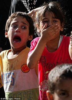 Anguish: Young relatives at the funeral of the four Palestinian boys who were killed today