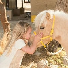 Kisses, little girl giving a sweet little kiss to a sweet little pony!