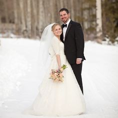 Real wedding—couple smiles in the snow in Jackson Hole, Wyoming