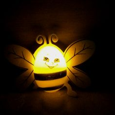 Fire Fly. Went to JayC Grocery Store and found bumble bee easter eggs. Put a battery operated tea light which made it look like a fire fly!  Cute idea for Easter!
