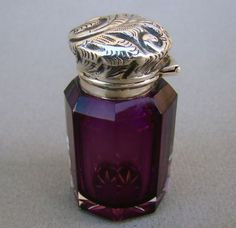 Victorian amethyst coloured glass and Sterling silver scent bottle by Mousley Bros.  Hallmarked Birmingham,1898