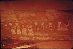 THIRTEEN FACES EAST (THREE FACES OUT OF CAMERA RANGE), IN HORSE CANYON. THESE PICTOGRAPHS ARE BELIEVED TO HAVE BEEN INSCRIBED 1000 YEARS AGO, 05/1972