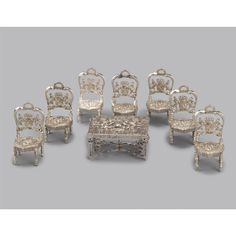 A DUTCH SILVER MINIATURE SUITE OF FURNITURE, APPLIED WITH THE ARMS OF THE NETHERLANDS, JACOB PIETER NIEKERK, SCHOONHOVEN, 1862-1900