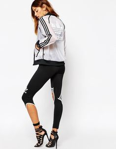 [adidas Originals Rita Ora Sheer Layer Bomber Jacket - $90 ] Sheer fabric.  Contrast binding.  Zip fastening placket.  Functional pockets.  Regular fit - true to size.  Machine wash.  100% Polyester.