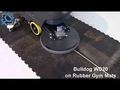 http://www.thesweeper.com/ Bulldog WD20 Walk Behind Floor Scrubber scrubbing rubber floor mats. Showing transition to two different surface heights as well as suction on gaps in between floor mats.