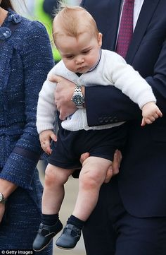 Wide awake: Prince George was alert and curious as he was held by his father as they made as the family prepared to leave New Zealand....April 16, 2014