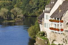 Beautiful houses on the shores of Dordogne River, Limousin, France.