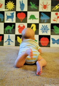 Damien loving his new picture board, 8 weeks old   Once baby is seeing more details ( rather than just outlines ), a great way to encourag...