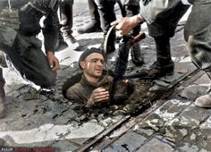 Polish insurgent fighter surrendered from his position in the sewers under Warsaw Poland 27 September Note MP 40 submachine gun. Poland Ww2, Germany Ww2, Warsaw Poland, Warsaw Ghetto Uprising, Polish Government, Poland History, Ww2 History, Man Of War, War Photography