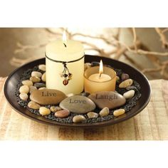 Centerpieces using candles and stones.