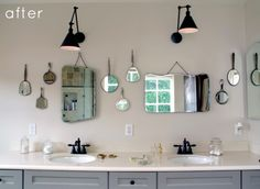 This bathroom with its grey vanity, quirky wall of mirrors and black accents is just so fun.