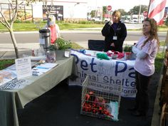 Pet Pal Animal Shelter Booth and volunteers