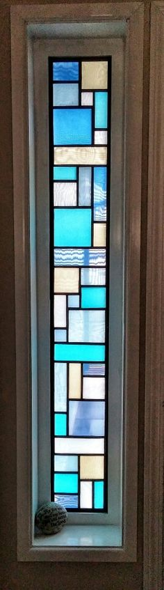 I made this faux stained glass window to cover a clear glass window beside our front door. Cut the black from posterboard with an xacto knife (2 mirror images), then selected six different colors of lining material and cut them to fit the squares. Glued one, two, or four layers depending on how opaque I wanted it. Used double stick tape to attach the two frames together & attach to the window frame. Was really pleased with how it turned out!