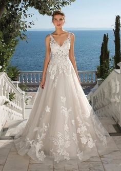 You will be a true bridal vision wearing this tulle ball gown adorned in Venice lace appliques from head to toe. Button and loop closures line the back. Stye also available with a lined bodice.