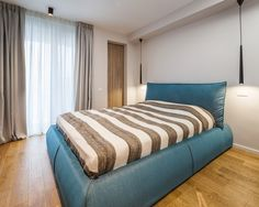 This one-bedroom apartment in Bucharest reflects the contemporary style and artistic pursuits of the artistic couple that owns it. Young Couple Apartment, Couples Apartment, One Bedroom Apartment, Contemporary Apartment, Contemporary Style, Large Wall Murals, Bedroom Decor For Couples, Bedroom Ideas, Couple Room