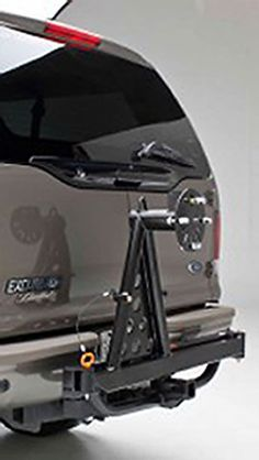 """Hitchgate™ spare tire carrier by Wilco Offroad secures up to a 40-inch spare tire. Mounts to any 2"""" receiver. Swing-away design for easy access to cargo."""