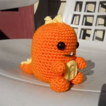 """Little Dino stands 4.5"""" tall, 6"""" long, and 9"""" around    He is made from worsted weight yarn and he has 12mm safety eyes.   Little Dino is made to order so colors are up to you.   Be sure to include your color choice in your order along with which color you want to be the main color.   I c..."""