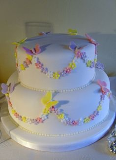 Two tier birthday cake with butterflies