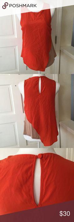 """NWT Anthro orange & tan asymmetrical blouse size S NWT Anthropologie orange and tan blouse  🐾 Anthropologie Bordeaux blouse 🐾 Bright orange outer layer with tan lining 🐾 Asymmetrical 🐾 Back neck button closure 🐾 Includes extra button 🐾 Bust: 17 1/2"""" 🐾 Length: 26"""" (longest point on front) 🐾 Length: 22"""" (side) 🐾 Self: 100% polyester 🐾 Lining: 94% rayon, 6% spandex 🐾 Hand wash, lay flat to dry  🐾 Bundle discount 🐾 No trades, no PP 🐾 Smoke free, pet friendly home Anthropologie Tops…"""