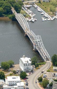 The swing bridge that carries Route 82 across the Connecticut River joins Haddam and East Haddam. In the foreground is the Gelston House ( lower left) and Goodspeed Opera House ( by the river).
