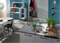 Bold color used in kitchen with one of Franke's new Fireclay by Villeroy & Boch 'D' bowl sinks.