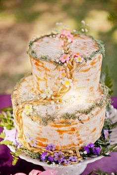 This Tangled-themed cake that's good enough to climb up. | 16 Perfect Disney Wedding Cakes You'll Want To Make Part Of Your World