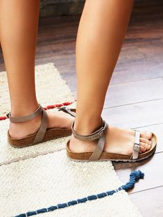 Daloa Birkenstock   Easy strappy sandals with an adjustable ankle strap and toe band with Birko-Flor uppers. Molded footbed and shock-absorbing EVA sole.