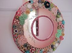 I have GOT to make something like this with all my extra vintage pieces...love it!