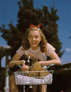Norma Jeane Dougherty (Marilyn Monroe) with puppy  DATE: 1946  ARTIST: Richard C. Miller