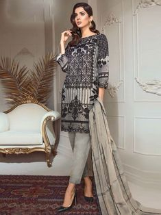 Radiant black and grey partywear straight cut suit online which is crafted from georgette fabric with exclusive embroidery work. This stunning designer straight cut suit comes with santoon bottom and chiffon with heavy work dupatta. Simple Pakistani Dresses, Pakistani Bridal Wear, Indian Dresses, Pakistani Suits, Indian Outfits, Best Designer Suits, Salwar Kameez Online Shopping, Women's A Line Dresses, Girls Frock Design