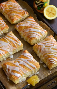 These easy little lemon cheesecake hand pies are made with puff pastry, filled with a cheesecake mixture and lemon curd, and topped with a sweet glaze. Lemon Desserts, Lemon Recipes, Tart Recipes, Appetizer Recipes, Sweet Recipes, Cooking Recipes, Apple Desserts, Easter Recipes, Dessert Recipes
