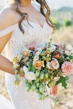 An arrangement just as magical as your special day. ✨ @carmensantorelliphoto captured allll the beauty of this lush, painterly creation. 💐 | Photography: @carmensantorelliphoto #stylemepretty #weddingbouquet #weddingflowers #weddingflorals #weddingdress Floral Wedding, Wedding Flowers, Wedding Dresses, Summer Wedding, Wedding Day, Bride Bouquets, Newlyweds, Bridal, California