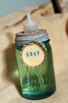 Soap Dispenser from mason jar. Pin verdict: this is just a photo, not a tutorial, but it's pretty easy to make...punch a hole with an awl and enlarge the hole with pliers, screwdriver, etc. until your soap top fits into it. Fill the jar with about a tablespoon of liquid soap and the rest water and you're good to go. I like coloring the water with food coloring too.