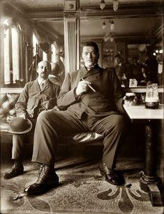 Big man enjoying a cigar and glass of beer in a New York tavern circa 1908