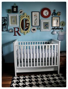 Nursery with a great installation of hanging wall art.  Great mix of size, shape, color and texture, which looks great and will hopefully hold baby's attention. -MMA