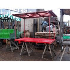 Case study stall - Trestle market stall with uprights & top - striped canopy. Additional stall items include tiered stand (steps) and grass matting. Stall board approx 6x4  SpecificationsWidth:2000mm, Height:2040mm, Depth:1050mm