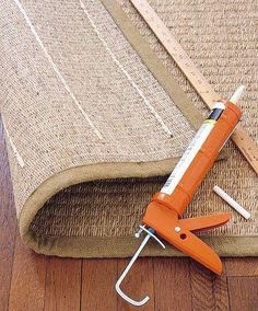 caulk the back of a rug to keep it from slipping on a floor