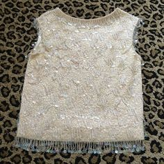 Vintage embellished top Fantastic condition. Stains on the arm pits (see picture posted) but you do not see the stains while wearing it! No size tag but fits a medium or 4/6 Tops Tank Tops