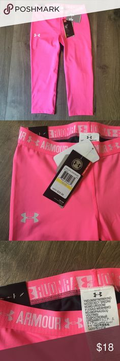 NWT Under Armour Pink and Grey Leggings Brand new with Tags!  Solid bright pink on the front with grey stripe running down the back.   Girls size medium.   👯♀️Bundle for savings! Under Armour Bottoms Leggings