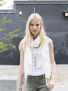 White singlet, white scarf, khaki jeans