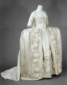 Court dress (Wedding dress), UK, 1775-1780, The plain fabric and restrained decoration are typical of the late 1770s.