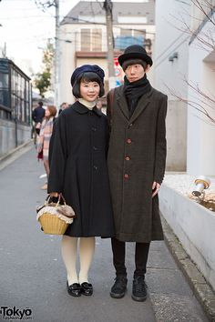 Aya & Shu on the street in Harajuku. She's wearing a Comme des Garcons coat with a bow beret and patent bow loafers. He's wearing a Christopher Nemeth coat with a bowler hat and Comme des Garcons x Nike sneakers.