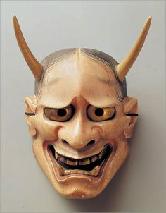 """The Hannya is a demon mask used in the Nō theater. """"The Hannya mask is said to be demonic and dangerous but also sorrowful and tormented, displaying the complexity of human emotions"""" (https://en.wikipedia.org/wiki/Hannya). What is important to notice is the various ways the mask can express emotion even though it is said to be """"nonexpressive."""" Its laughing expression may suggest evil but its eyes are rather troubled and lonesome showing a distressed life. (D. Jacobo)"""