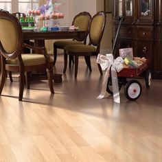 This Canadian maple laminate flooring is a perfect fit for high-traffic dining rooms. DIY installation is easy, too, with the interlocking planks.