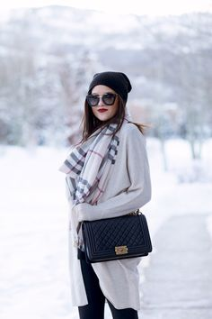 Beautiful scarf from Burberry, a nice big sweater, cute sunglasses, a great bag, and lip stick that pops